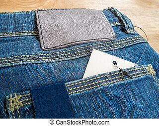 Jeans with deerskin label and price tag - Close-up of blue...