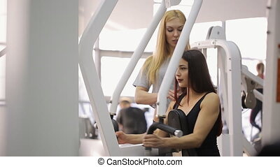 Beautiful brunette trains hard on trainer of Hammer under...