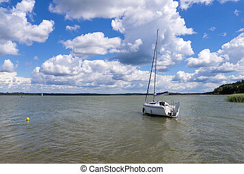 Landscape on Mazury - The boat on the lake Ros - Masuria...