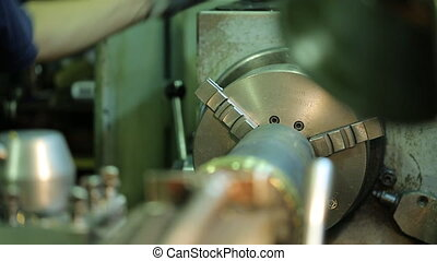 Hand of worker in glove involve a machine for processing of...