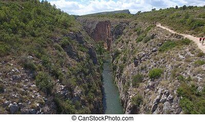 Aerial view of Canyon and suspension bridges in Chulilla -...