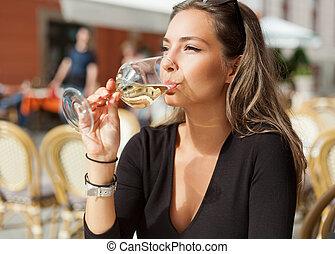 Brunette beauty having wine fun. - Portrait of a gorgeous...