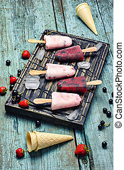 Ice cream and waffle cones - Ice-cream and summer berries in...