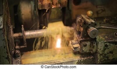 Process deep hole drilling on a lathe using a generous flow of coolant, rotating portion.