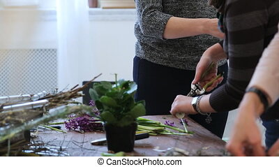 Group of women crafts floral decoration on seminar in art...