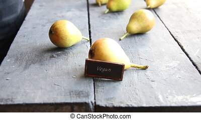 Vegan food concept - Juicy flavorful pears on a wooden table...