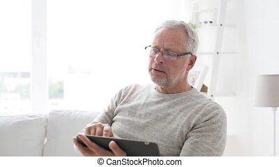senior man with tablet pc at home 5 - technology, people and...