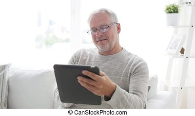 senior man with tablet pc at home 7 - technology, people and...