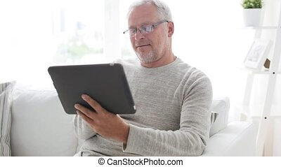 senior man with tablet pc at home 8 - technology, people and...