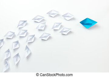 Leadership concept illustrated with paper ships - Leadership...