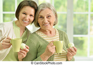 Senior woman with daughter with tea - Portrait of Senior...
