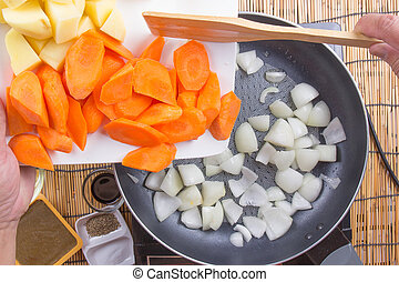 Chef putting vegetable to the pan for cooking Japanes pork...