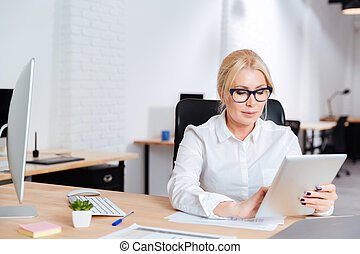 Businesswoman working in office with pc tablet