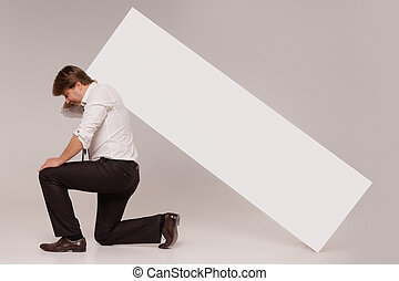 Kneeled businessman with blank copy space banner - Kneeled...