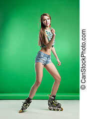 Very attractive woman with lollipop posing on green studio...