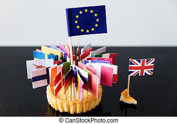 flags of european union in a cake, only a small crumb for...