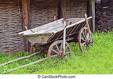 Vintage wooden cart - Ancient wooden cart standing on a...