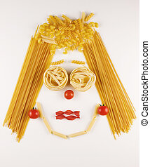 face made with different kind of raw pasta