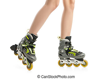Close up picture of woman's legs with rollerskates isolated...