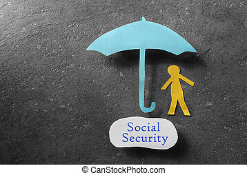 Social Security message - Paper person under umbrella with...
