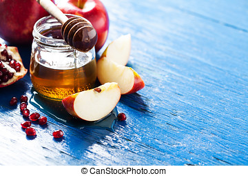 Rosh hashanah jewesh holiday concept: honey, apple and...