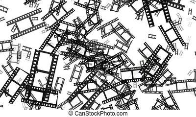 Flying film tape fragments in black on white