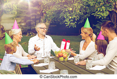 happy family having holiday dinner outdoors - family,...