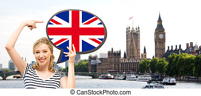 woman with text bubble of british flag in london - foreign...