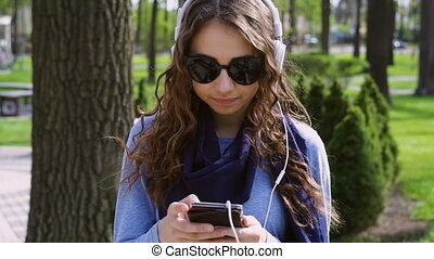 beautiful woman with a smartphone listening to music