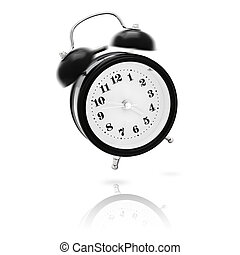 wake up! - vintage alarm clock ringing and jumping in the...