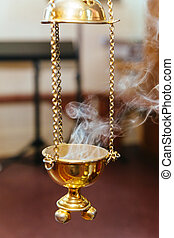 priest singing in a christian sermon censer church rite foog