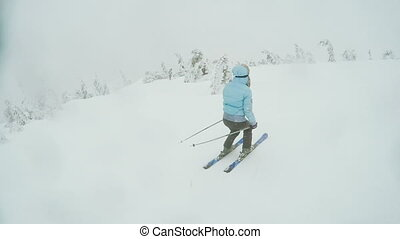 Woman Ski descent in nature - Woman riding on skis woman