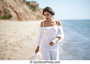 Girl in  white on the beach