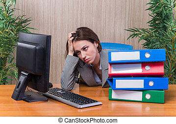 Tired woman stressed with too much work