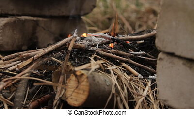Smoldering bonfire with smoke. - Flames of wood ember for...