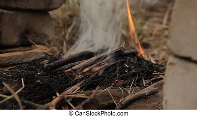 Wood ember with smoke and spurts of flame. For grill and...
