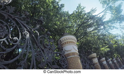 High Forged fence summer - Camera shoots from below wrought...