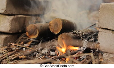 Burning wooden logs with smoke and flash fire. - Burning...