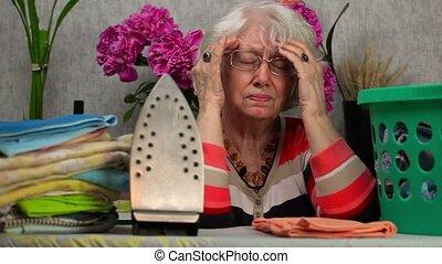 Ederly woman with headaches near