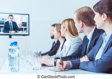 Video training for high management staff - Row of...