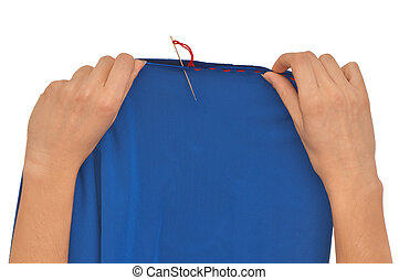 mending - Woman mending blue material with red sewing