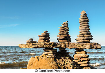 Stacks of pebbles - Balance a few stack of pebbles on rocky...