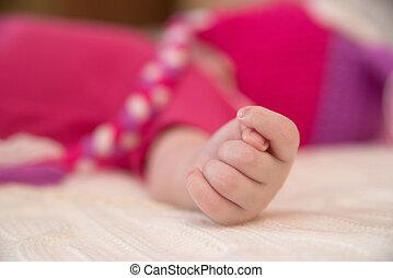 Close-up photo of newborn baby hand