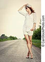 girl hitchhiker - Hitchhiking girl. Attractive young woman...