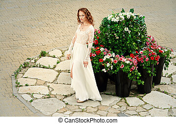 brilliance - Beautiful young woman in luxurious white dress...