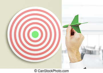 Businessman hand playing darts - Targeting concept with...