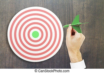Businessman playing darts - Targeting concept with...