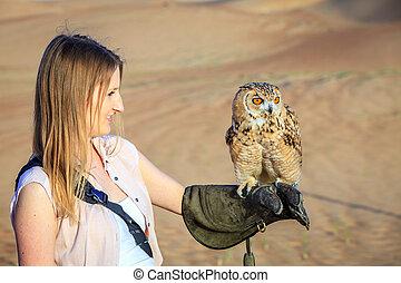 Desert Eagle Owl in training - Desert Eagle Owl sits on a...