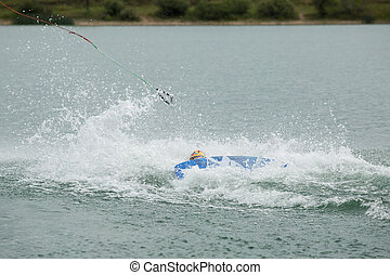 wakeboard athlete fell into the water with big splashing