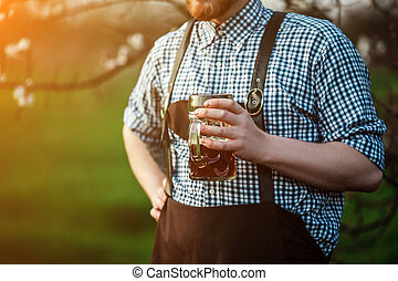 Happy smiling man tasting fresh brewed beer on the...